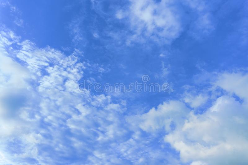 Beautiful view of white fluffy clouds on a clear blue sky background. Nature weather on the vast cloud blue sky. Sky daylight in s. Ummer. Natural background stock image