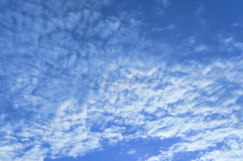 Beautiful view of white fluffy clouds on a clear blue sky background. Nature weather on the vast cloud blue sky. Sky daylight in s. Ummer. Natural background royalty free stock image