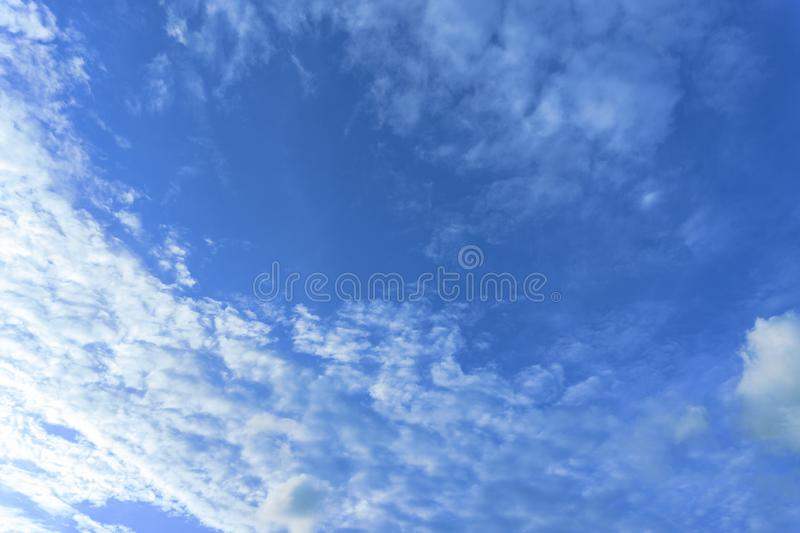 Beautiful view of white fluffy clouds on a clear blue sky background. Nature weather on the vast cloud blue sky. Sky daylight in s. Ummer. Natural background stock photo