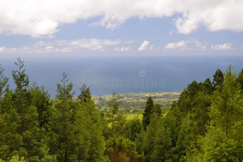 Beautiful views of the green forest, mountains and lake cloudy weather. Attractions on the island of San Miguel, Portugal. Travel stock photos