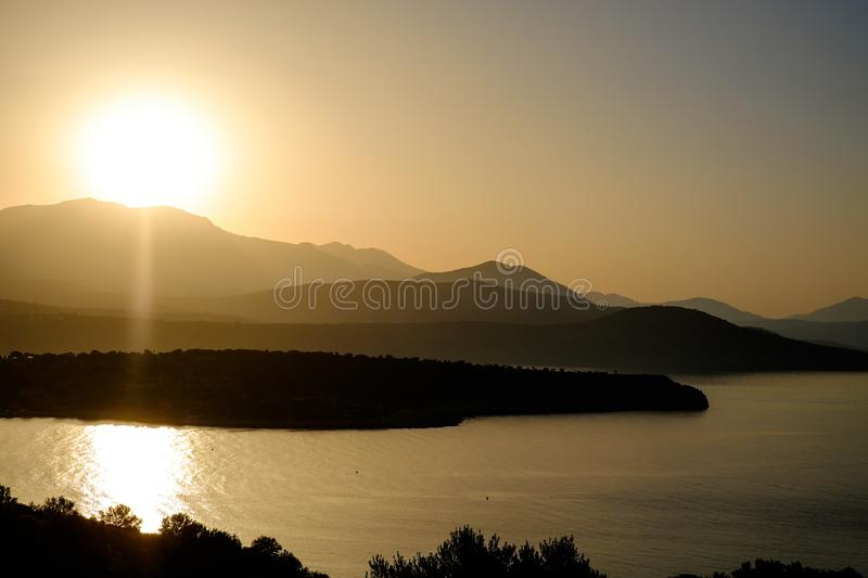 Beautiful views of the sea and mountains. Sunset royalty free stock images