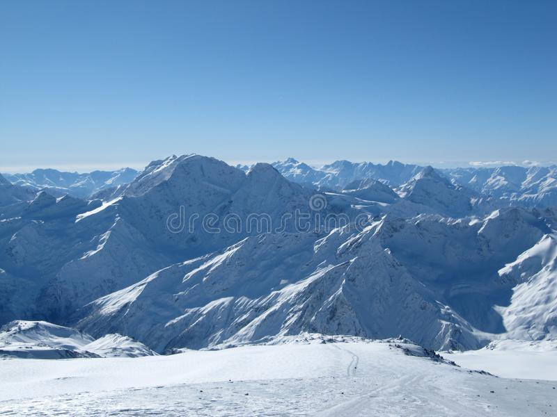 Beautiful views of snow-capped mountains at noon stock photo