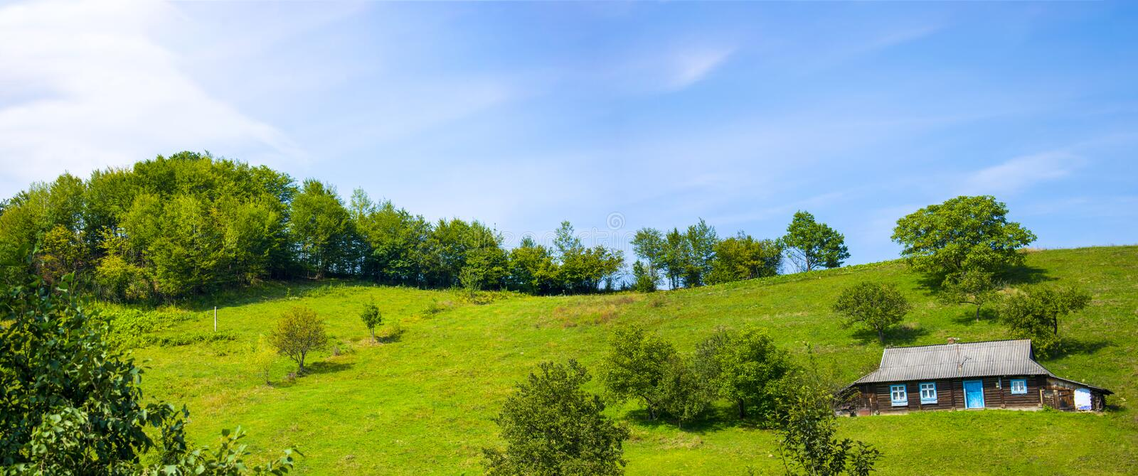 Beautiful village log house on a hill stock images