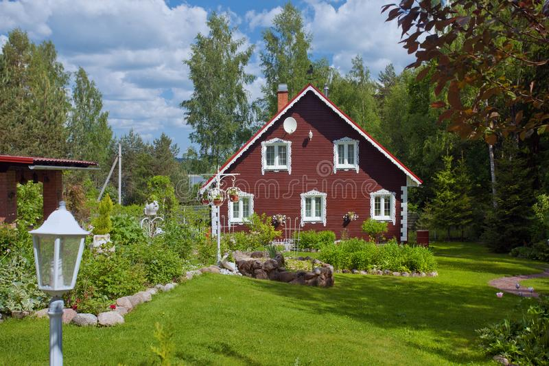 Village house with a garden. A beautiful village house with its garden stock images