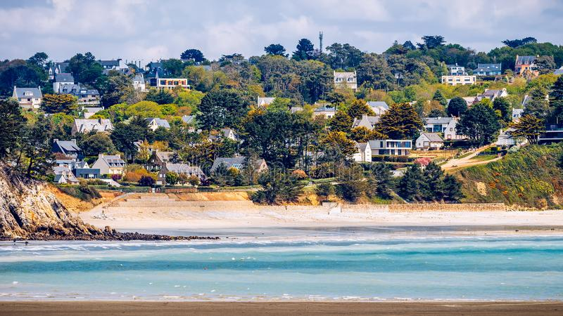 Beautiful village of Morgat with the sand beach and rocky coastline, Finistere, Brittany (Bretagne), France. stock photography