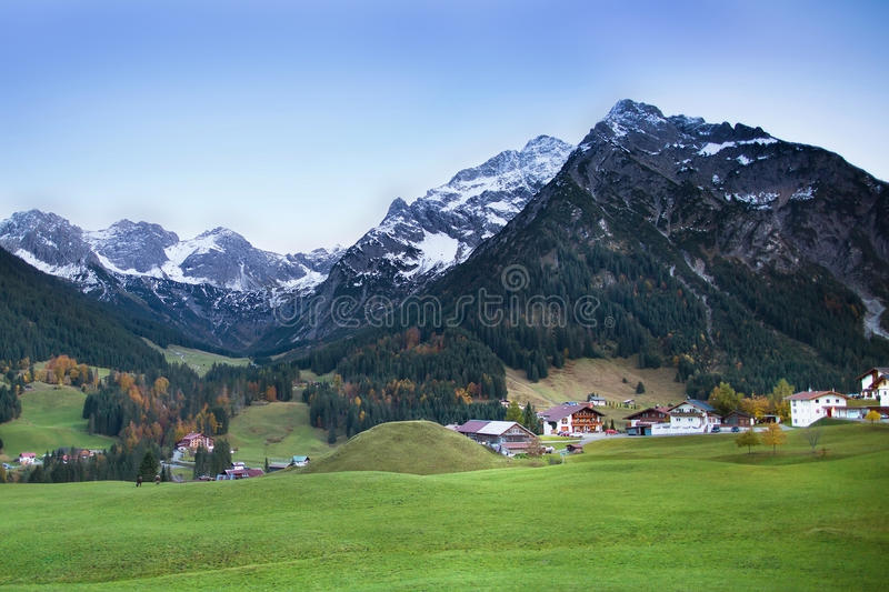 Download Beautiful Village Between Snow Covered Mountains Stock Image - Image: 41527623