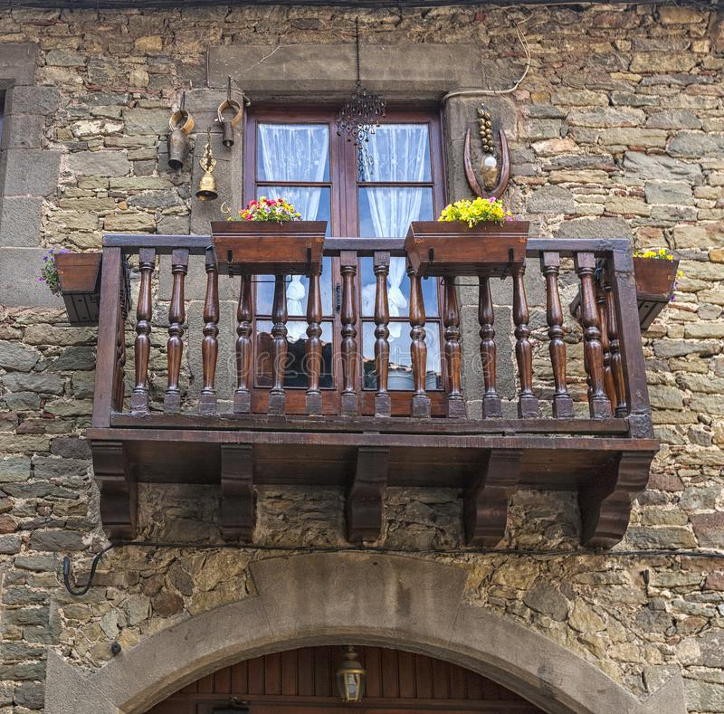 Beautiful vintage balcony with colorful flowers and wooden doors. royalty free stock photo