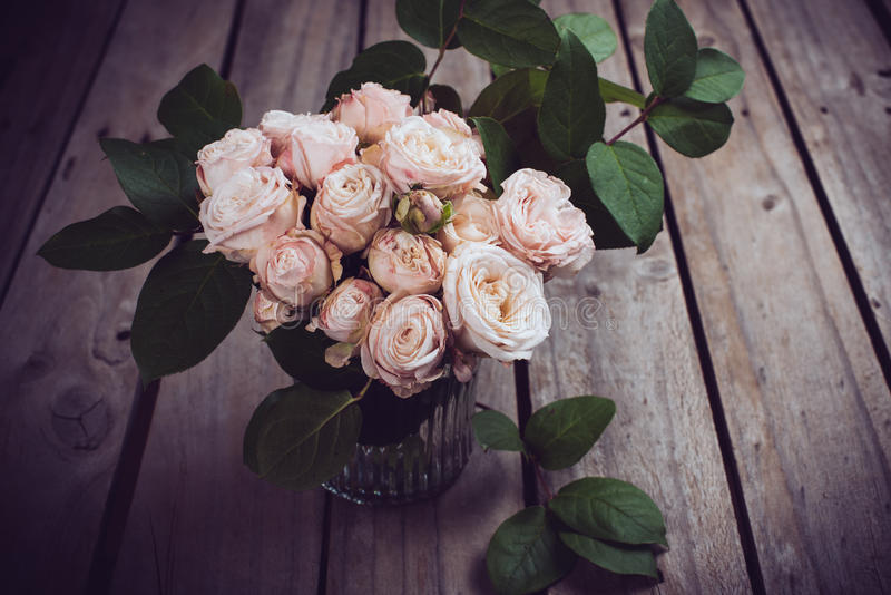 Beautiful vintage bouquet of fresh roses on wooden board royalty free stock photo