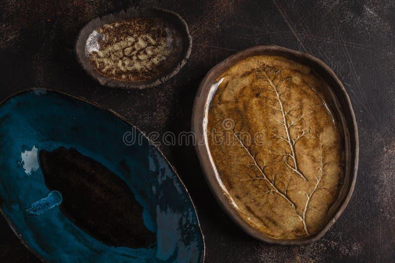 Beautiful vintage empty dark dishes on a dark rusty background. stock photo