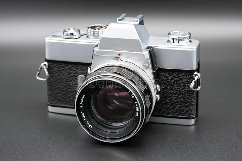Beautiful vintage film camera on grey background. In a studio royalty free stock photography