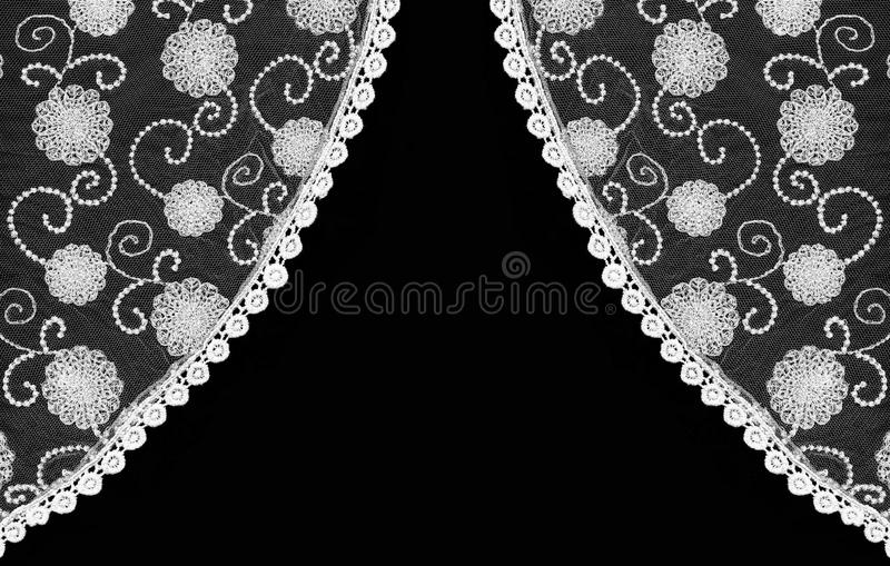 Beautiful vintage floral lace curtain. Isolated on black background stock photography