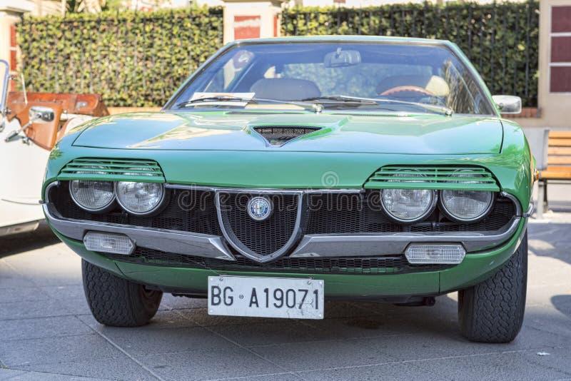 A beautiful vintage green car model Alfa Romeo Montreal manufactured by Italian Alfa Romeo stock image