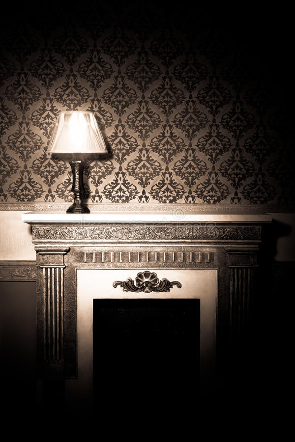 Beautiful vintage interior with lamp on fireplace royalty free stock photos