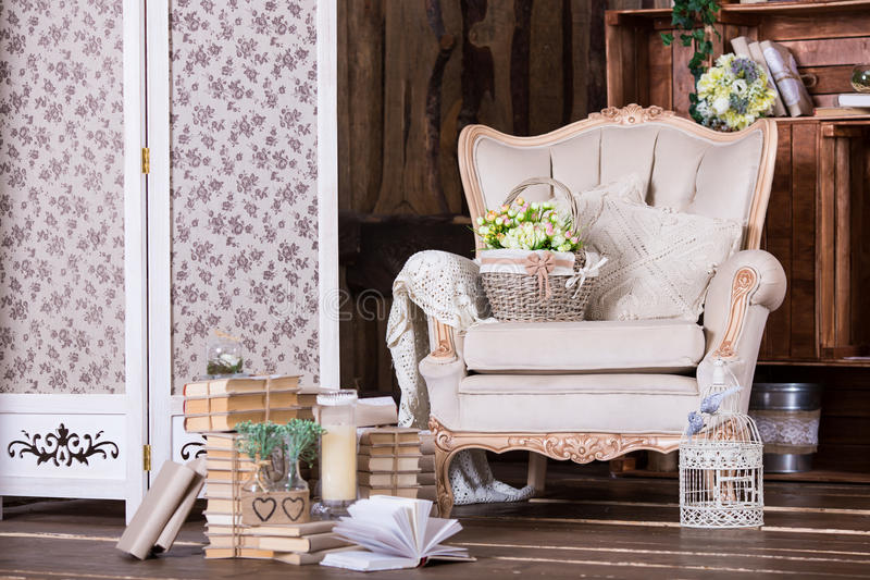 Beautiful vintage interior with old chair and book heaps royalty free stock images