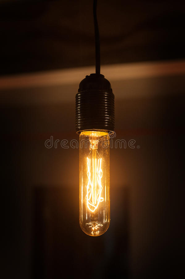 Beautiful vintage lamp shines in the room stock image