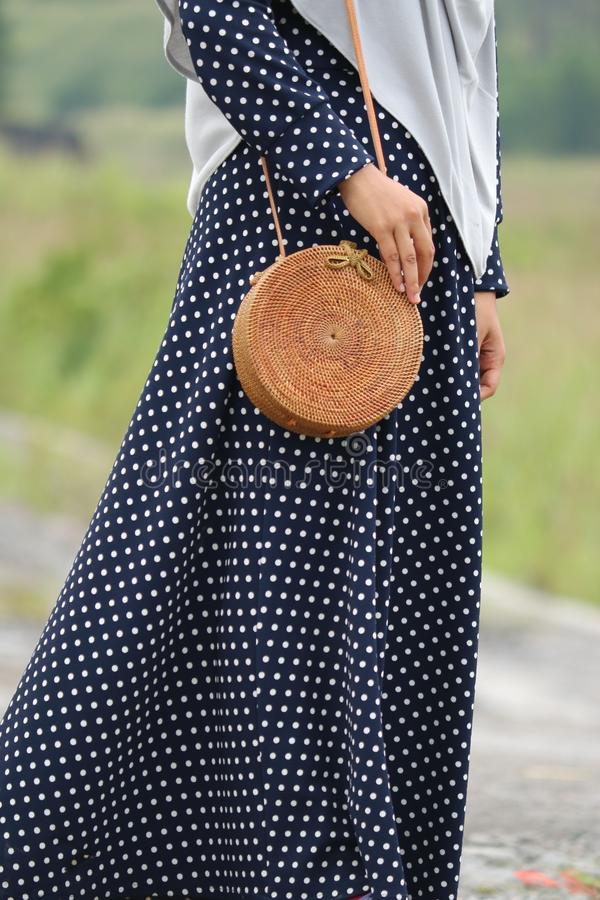 Beautiful Vintage Rattan Bag for Woman. Bag made of rattan, simple ethnic and unique. gives the impression of vintage and retro royalty free stock image