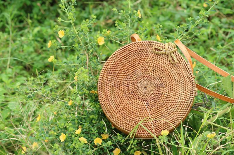 Beautiful Vintage Rattan Bag for Woman. Bag made of rattan, simple ethnic and unique. gives the impression of vintage and retro stock photos