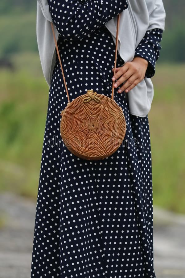 Beautiful Vintage Rattan Bag for Woman. Bag made of rattan, simple ethnic and unique. gives the impression of vintage and retro stock photo