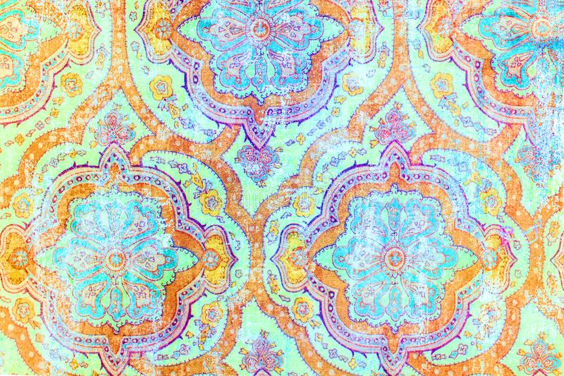 Beautiful vintage repeat patterned paper background. A closeup of a beautiful retro repeat patterned paper background in bright blue and orange stock photo