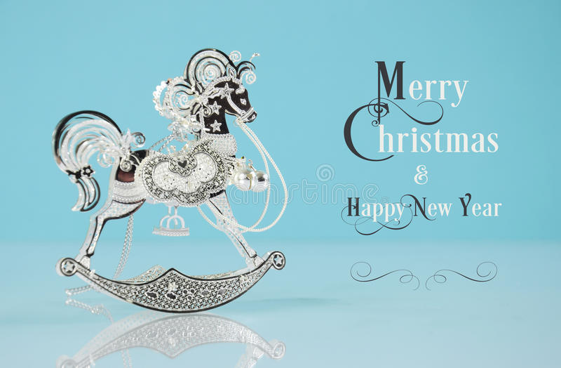 Beautiful vintage silver rocking horse ornament with sample text stock images