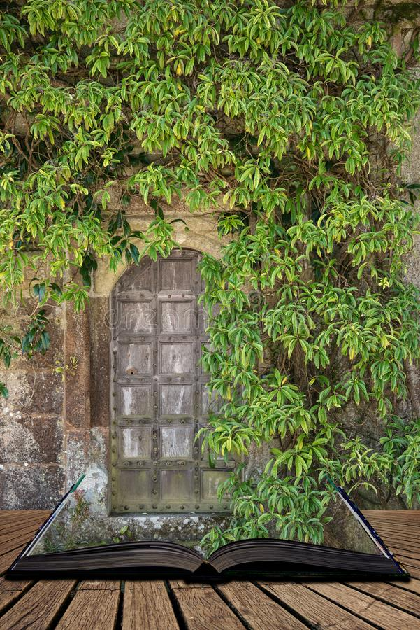 Beautiful vintage Victorian mansion entrance door surrounded by plants and tree coming out of pages of open story book. Beautiful old Victorian mansion entrance royalty free stock photography