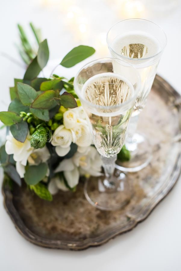 Beautiful vintage wedding decoration with champagne and white fl stock photography