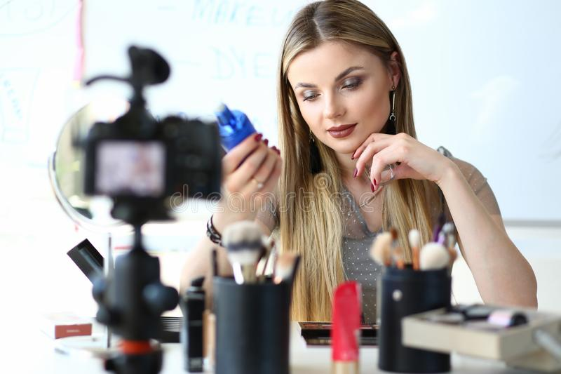 Beautiful Vlogger do Makeup Beauty Product Review royalty free stock photo