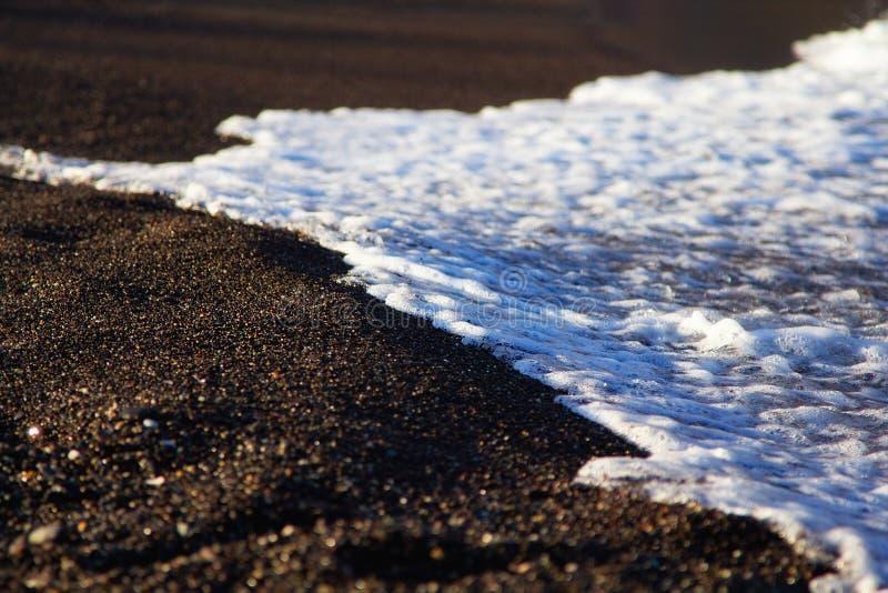 beautiful volcanic beach of Perissa, Santorini island, Greece royalty free stock images