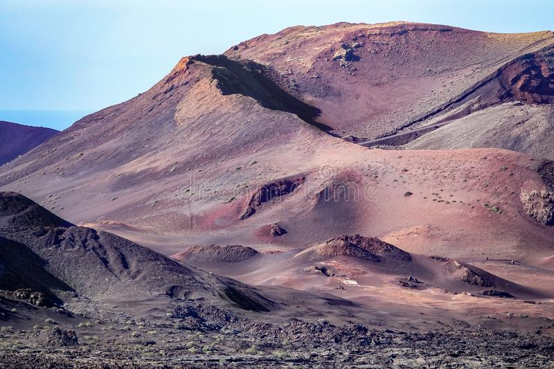 Beautiful volcanic landscape background. Mountain range with lava fields in the foreground. Lanzarote, Canary Islands stock images