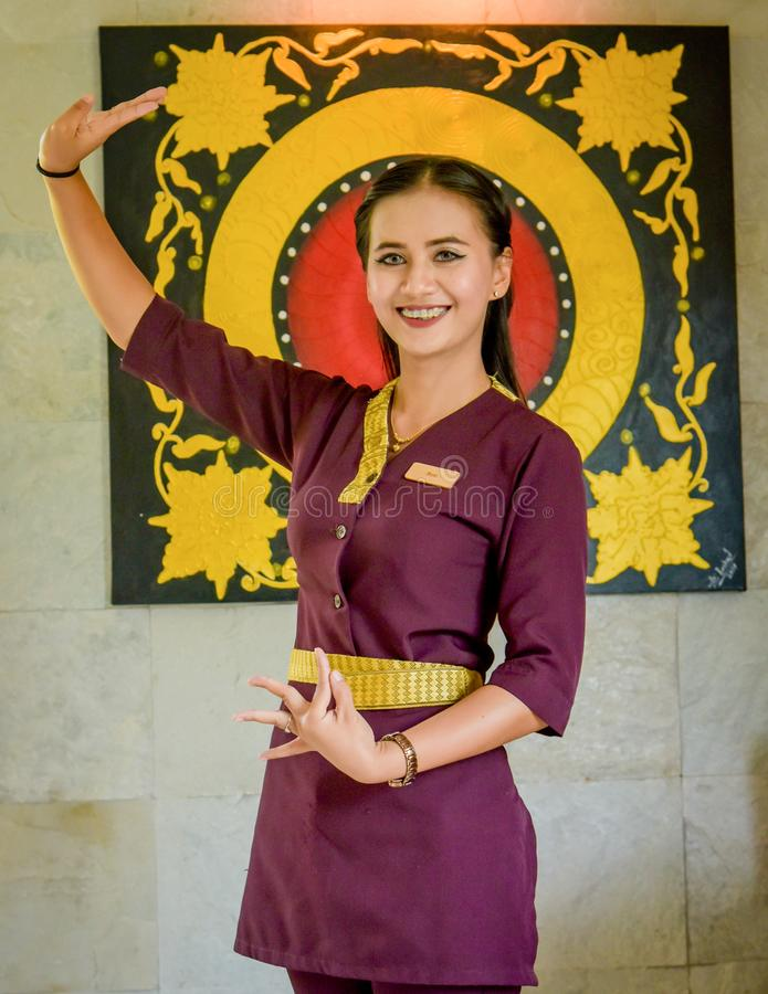 Beautiful waitress wearing uniform in the thai restaurant stock photos