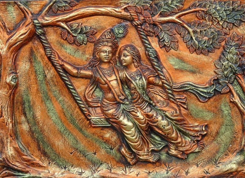 beautiful wall art hindu god couple sri krishna radha decorative playful vrindavan garden using rocking cradle swing 168359694