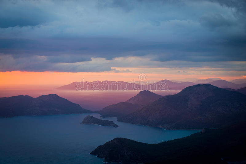 Beautiful wallpaper for your desktop, landscape sunset coast of. Landscape sunset coast of the Mediterranean sea, the silhouette of the mountains and islands stock photo