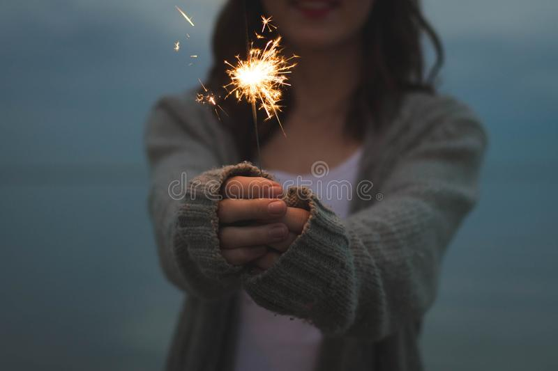 BEAUTIFUL WALLPAPERS LIGHTING A CRACKER. FROM INDIA ITS A AWESOME LIGHTING A CRACKER BLUR BACKGROUND REALLY DIVINE JUST LIKE BURNING A CRACKER IN DIWALI royalty free stock images