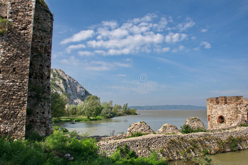 Beautiful walls and towers of medieval fort at River Danube. Golubac, Serbia - September 21, 2014: Landscape of walls and octagonal tower of the Medieval fort of stock photo