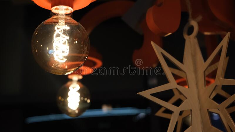 Beautiful warm light from the lamp, modern decor. Concept. Retro edison light lamp decor, light lamp electricity hanging. Decorate home interior stock image