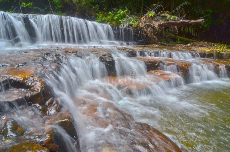A beautiful scenery of Atas Pelangi Waterfall in Pahang, Malaysia. A beautiful water flow of Atas Pelangi Waterfall in Pahang, Malaysia stock images