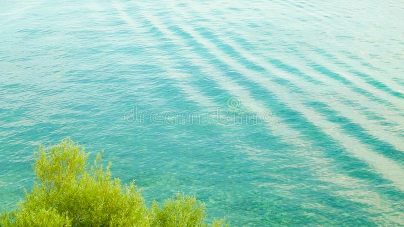 Beautiful water of Lake Ochrid as nature background. Ochrid is the oldest lake in Europe. Mediterranean nature, copy space stock photo