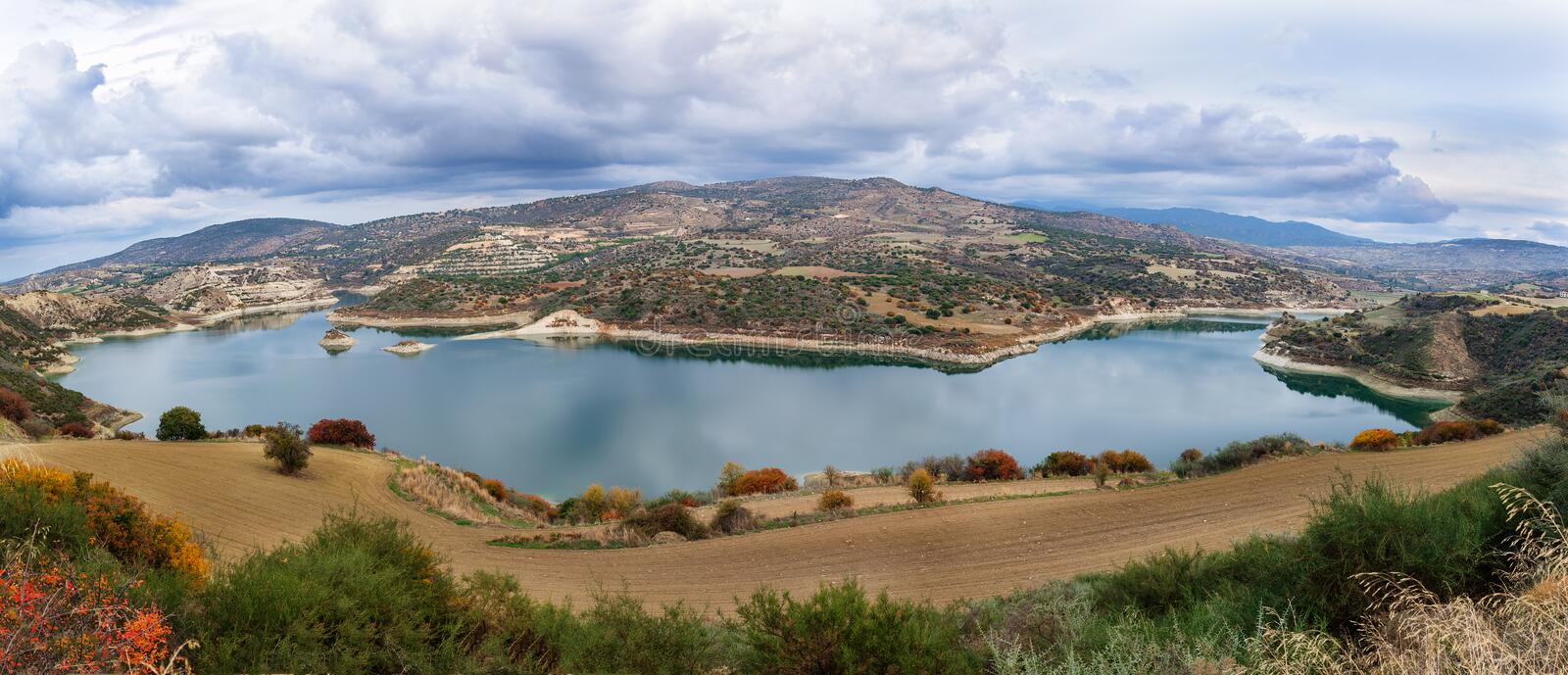 Beautiful water reservoir under the cloudy sky. stock image