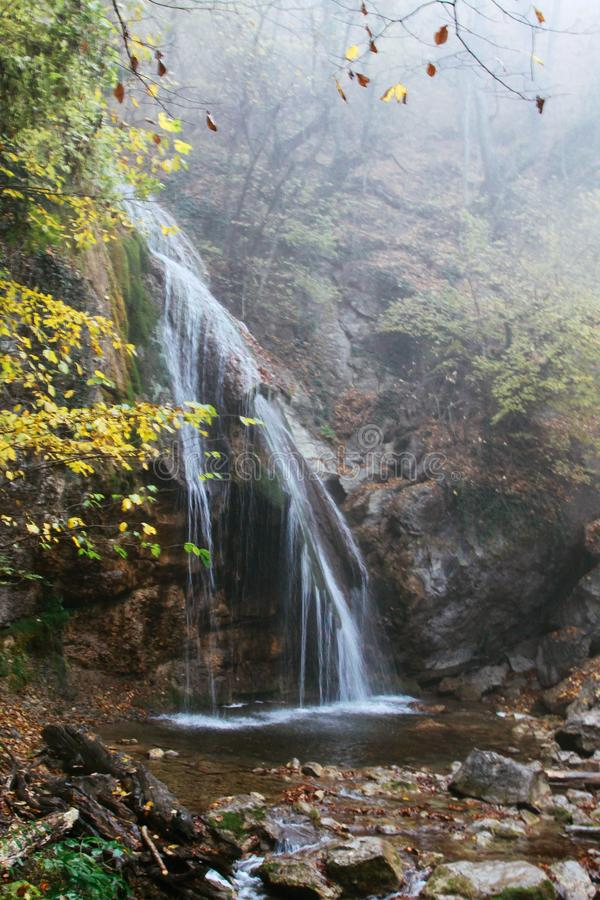 Beautiful waterfall in autumn forest in crimean mountains. Waterfall Jur-Jur, Crimea. stock photography