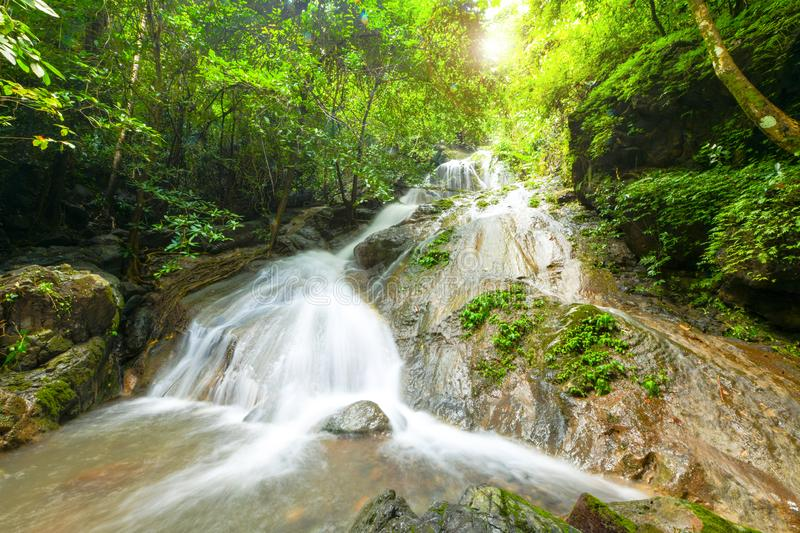 Beautiful waterfall in deep forest and soft water of the stream at the natural park in Thailand. Beautiful waterfall in deep forest and soft water of the stream royalty free stock photography