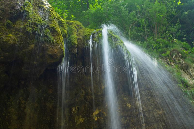Waterfall over granite rocks fast water flow. Beautiful waterfall landscape on granite stones. fast water flow with blur effect royalty free stock photo