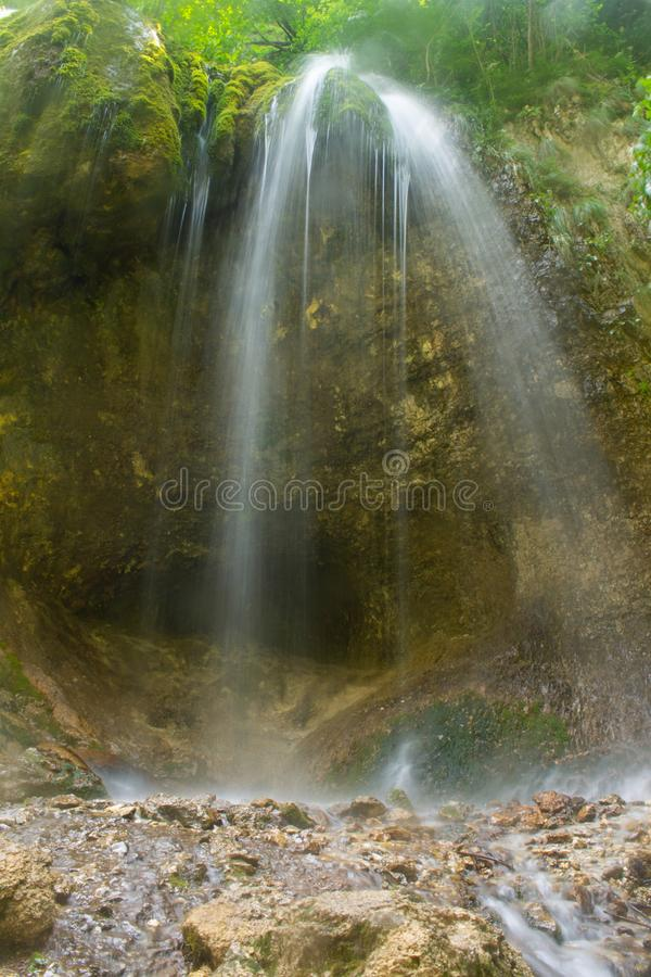 Waterfall over granite rocks fast water flow. Beautiful waterfall landscape on granite stones. fast water flow with blur effect royalty free stock image