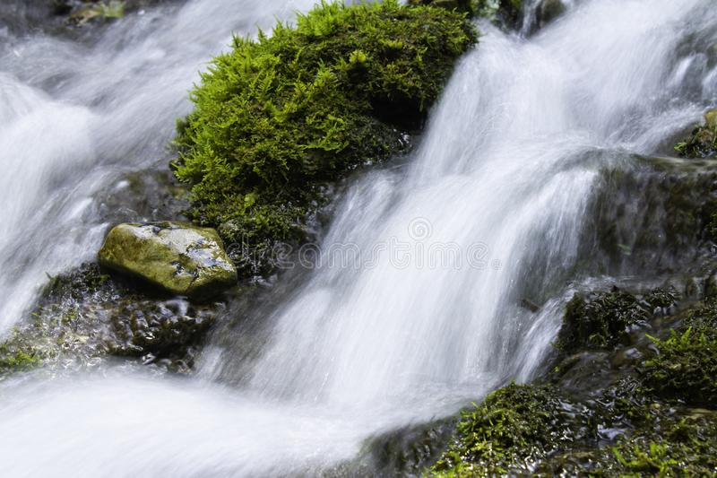 Waterfall over granite rocks fast water flow. Beautiful waterfall landscape on granite stones. fast water flow with blur effect royalty free stock photos