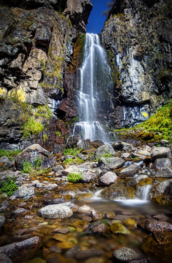 Beautiful waterfall in the mountains royalty free stock photography