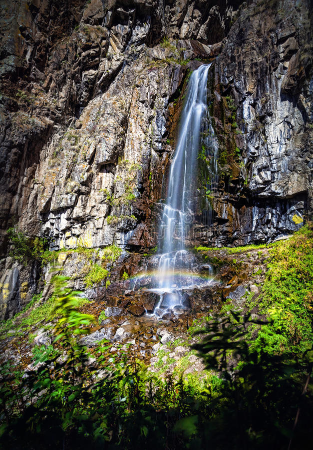Beautiful waterfall in the mountains royalty free stock image