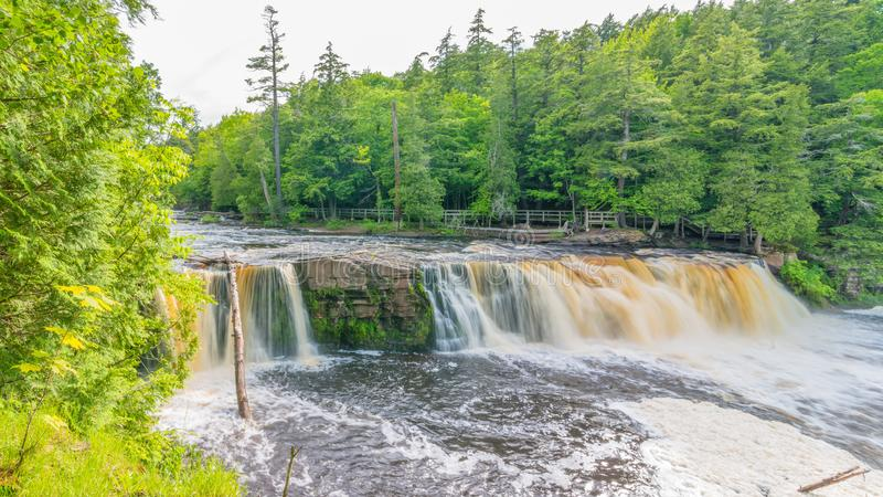 Beautiful waterfall at Porcupine Mountains Wilderness State Park in the Upper Peninsula of Michigan - smooth tranquil flowing wate. R royalty free stock photography