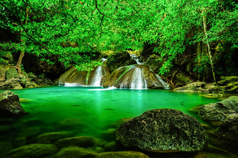 Beautiful waterfall in the rainforest jungle of thailand. Erawan waterfall in Erawan National Park, kanchanaburi,Thailand royalty free stock photography