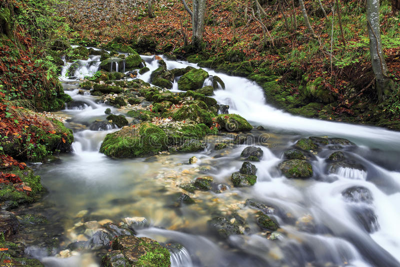 Beautiful Waterfall. Waterfall and river in late autumn stock photography