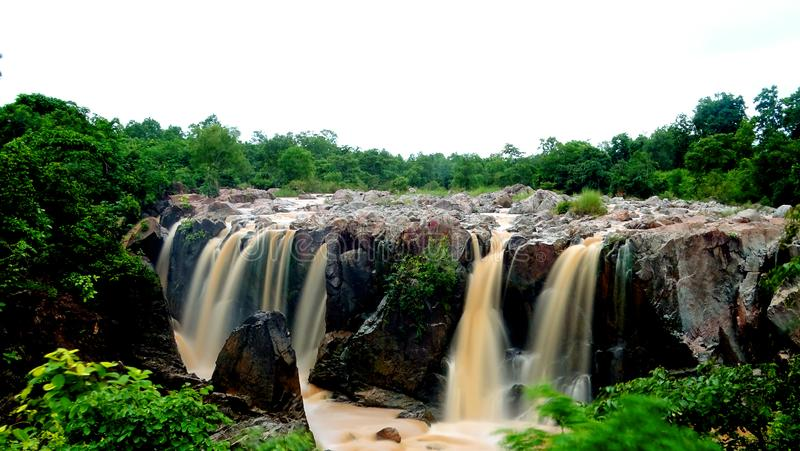 A Glistering Waterfall. This beautiful waterfall is situated at Keonjhar odissa India. It is having around 50 ft height. Wonderful view. You can stand here hours royalty free stock image