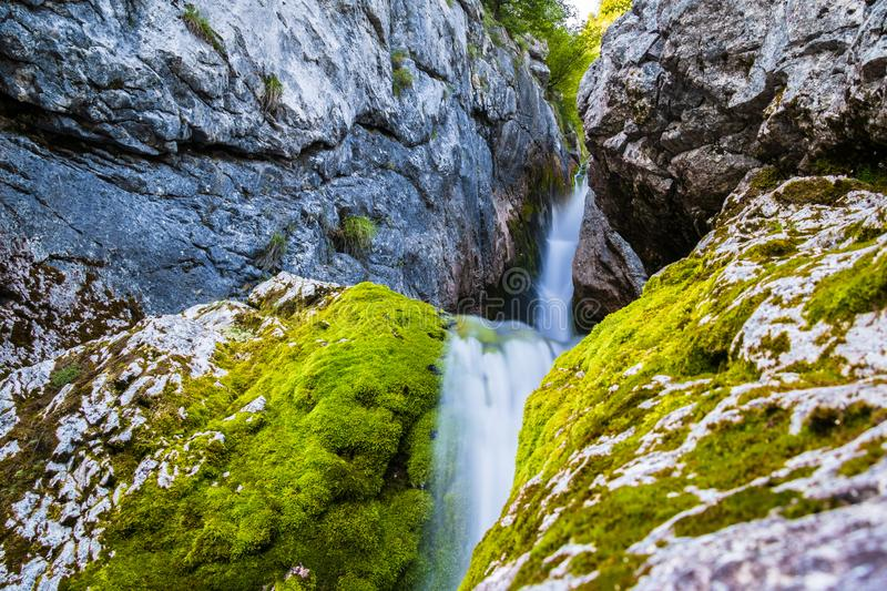 Beautiful Waterfall of Soca River near the Source of Soča. First Kilometer after main Pond Cave in Julian Alps. Bovec, Gorizia, stock image